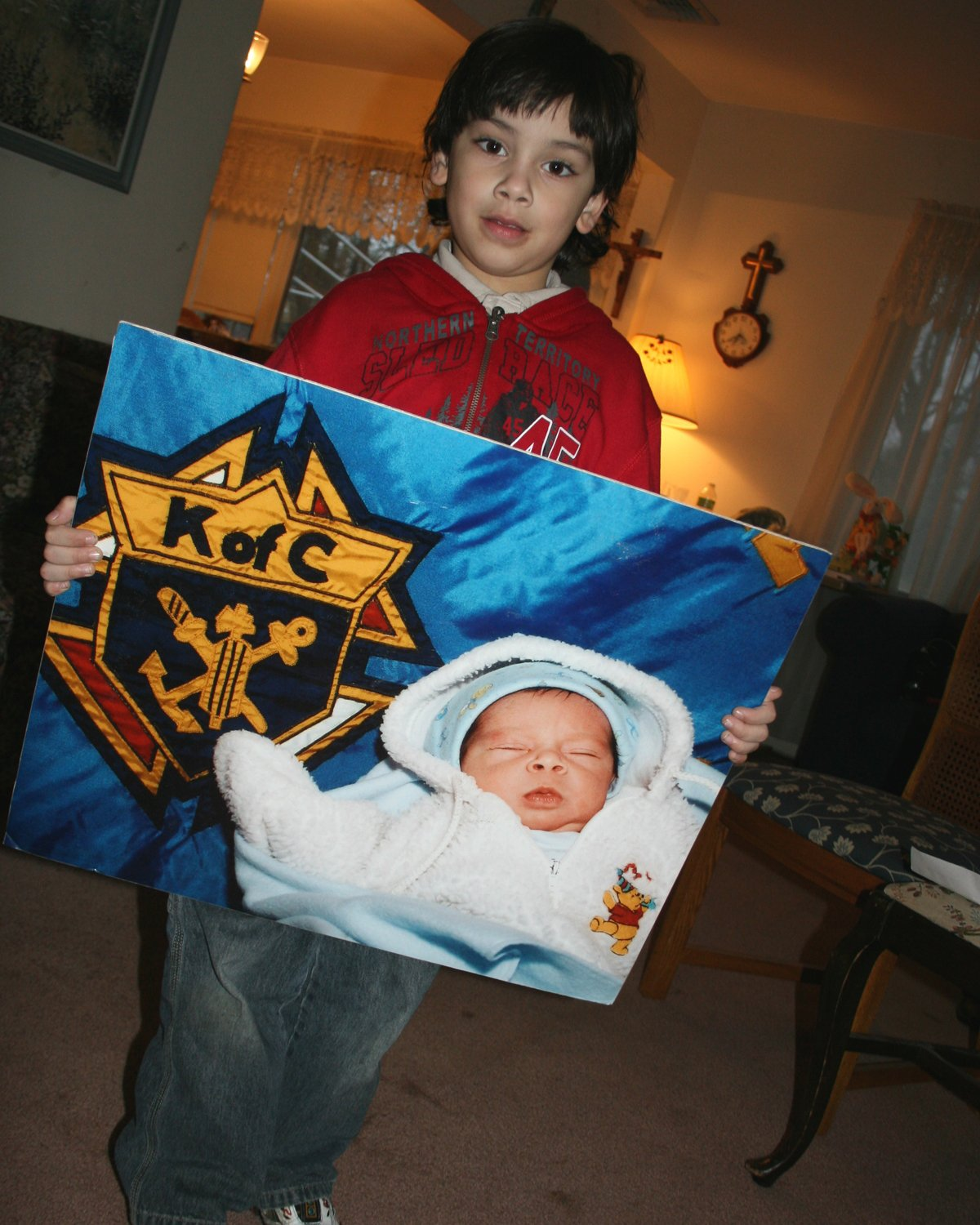 Jonathan holding a Knights of Columbus poster