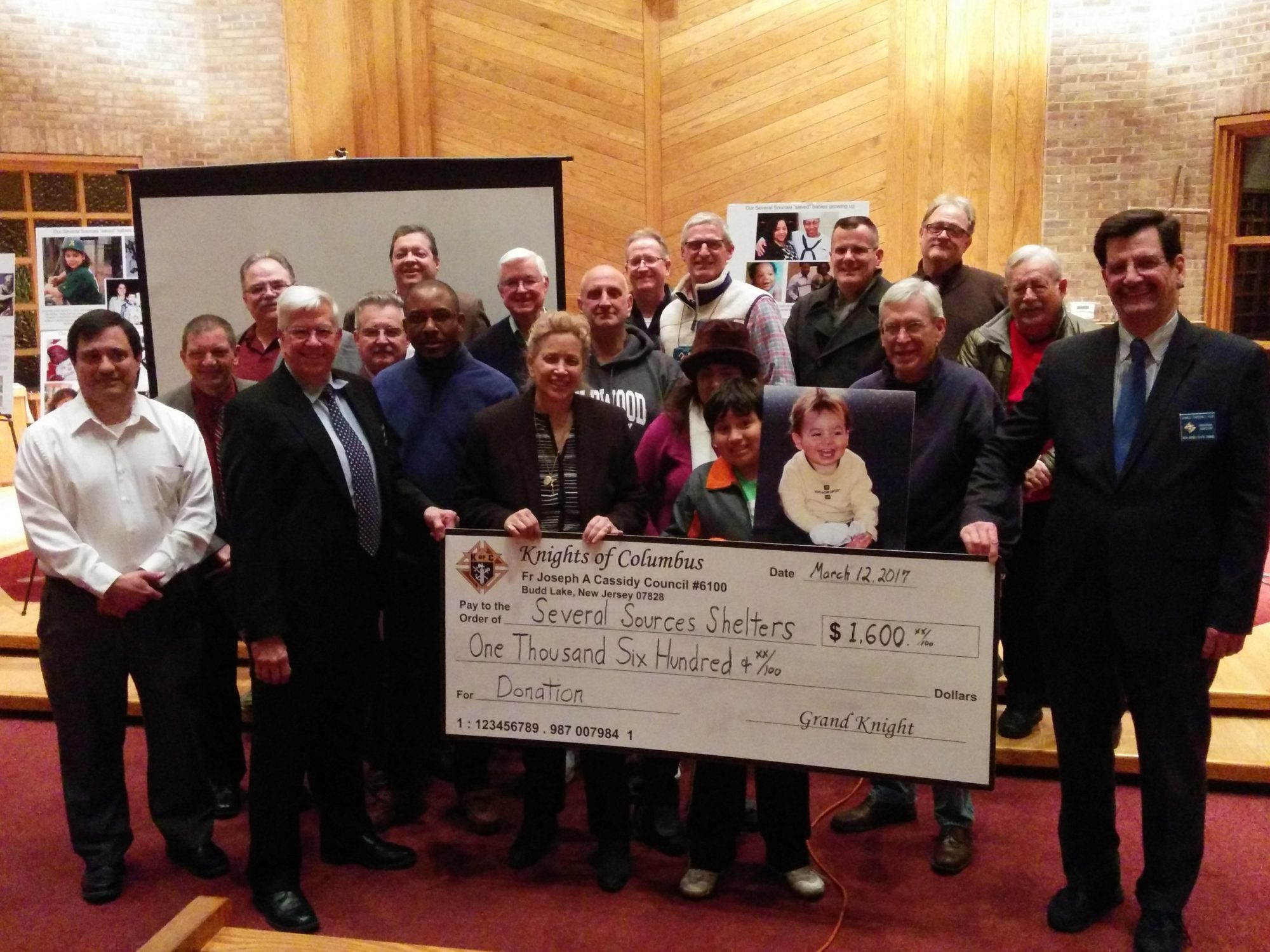 The Knights of Columbus present Kathy DiFiore with donation check