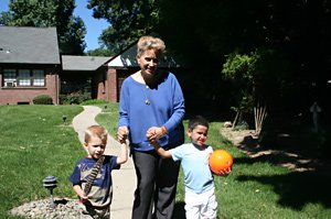 Kathy walking with Elijah and Danny